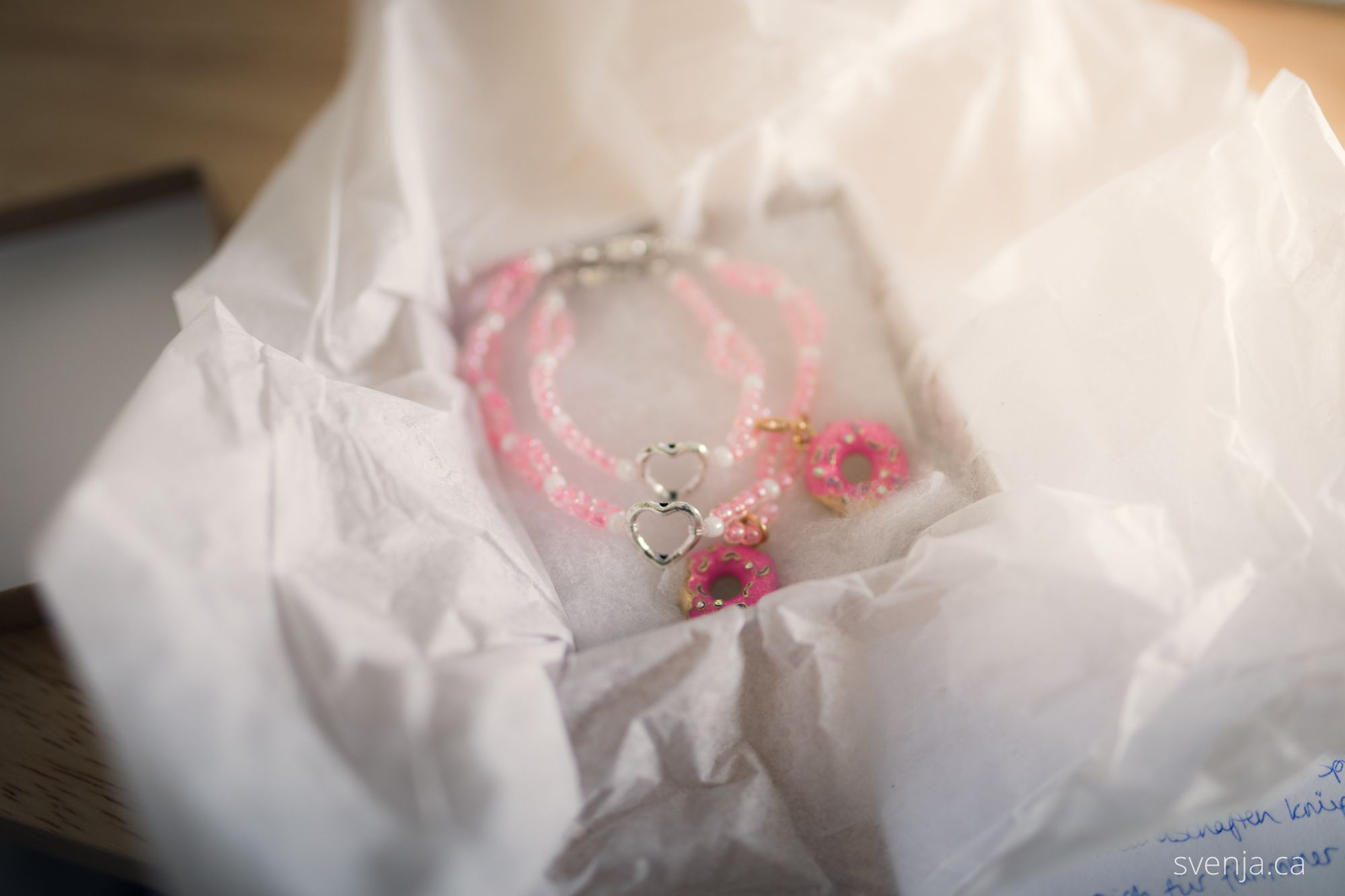 two bracelets lay in an opened box